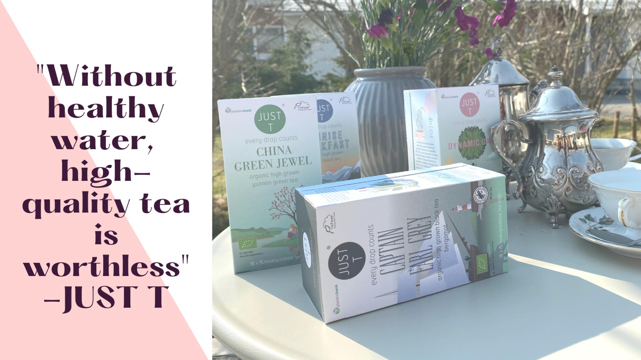 """vastuullisia teehetkiä, Just t teepaketteja pöydän etualalla, aurinko paistaa, pöydällä myös hopeinen teekannu ja kaunis kahvikuppi asettimella, kukkamaljakko taustalla, teksti """"Without healthy water,  high-quality tea is worthless"""" -JUST T"""